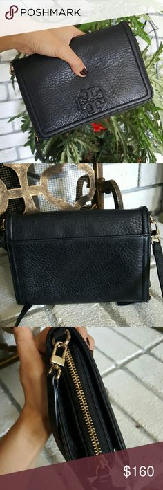 Tory Burch Thea Leather Crossbody Handbag I have a Tory Burch handbag.. Called the Thea flat wallet crossbody.. Black leather with gold tone.. It's in ok condition.  Hardware shows some discoloration and one of the buckles are broken. PLEASE NOTE IT IS STILL ATTACHED AND FUNCTIONAL.  Has some slight marks on outside leather and on inside  Authentic! Tory Burch Bags Crossbody Bags