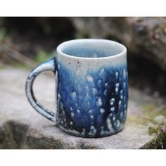 """""""A medium mug from the latest firing heavily coated with soda. These blue pieces are dipped in red shino before having a layer of black and cobalt stain…"""""""