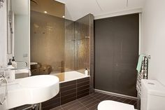 Family bathroom with concealed euro laundry