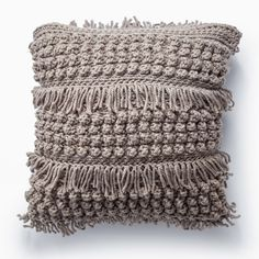 These crocheted pillows are sure to make a big impact! Made in Bernat Softee Chunky, the Tassels and Popcorn stitch really shine! Yarnspirations | Crochet | Free Pattern