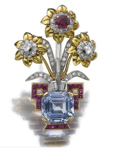 Of giardinetto design, the vase decorated with a step-cut sapphire, further set with calibré-cut and cushion shaped rubies, circular-, single-cut and baguette diamonds, signed Cartier Paris and numbered, French assay and partial maker's marks, case stamped Cartier.