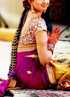 South Indian bride. Diamond Indian bridal jewelry. Jhumkis.Purple silk kanchipuram sari with contrast embroidered blouse.Braid with fresh jasmine flowers and gold jada. Tamil bride. Telugu bride. Kannada bride. Hindu bride. Malayalee bride.Kerala bride.South Indian wedding.
