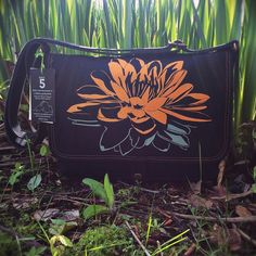 Handcrafted canvas messenger bag with a unique Wild Lotus print on the flap and an entomology print lining.