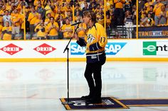 Keith Urban Photos Photos - Keith Urban performs the national anthem prior to Game Three of the Western Conference Final between the Anaheim Ducks and the Nashville Predators during the 2017 Stanley Cup Playoffs at Bridgestone Arena on May 16, 2017 in Nashville, Tennessee. - Anaheim Ducks v Nashville Predators - Game Three
