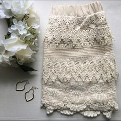 Coveted Clothing // English Rose Crochet Skirt This beautiful mini skirt pairs well with a silky blouse for summers hot days. Sizing is juniors size so it fits more like an x small/small in women's sizing. Elastic waist and crochet layers of lace in an off white color. Has been worn but is in excellent condition. Coveted Clothing Skirts Mini