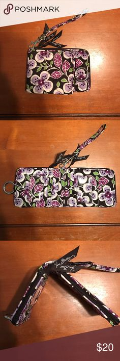 Vera Bradley Wristlet Vera Bradly Wristlet with two zipper pockets, 4 card/ID slots and a magnetic button front. The pattern colors are brown, green, pink, light purple and red/violet color. Only used a few times, in excellent condition. Vera Bradley Bags Clutches & Wristlets