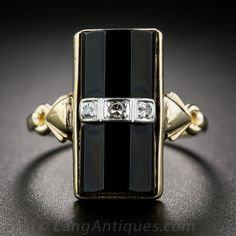 Art Deco Onyx and Diamond Ring. A sleek and streamlined Art Deco dinner ring rendered in sturdy 10 karat yellow gold. Three single-cut diamonds flash across the center of the black onyx beveled column, creating a diamond bridge with the geometrically flared band. Bold, striking and sophisticated in a ring size 5 3/4. 11/16 inch long.
