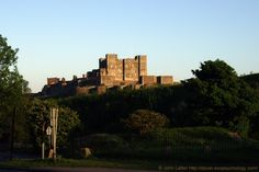 The Norman Keep of Dover Castle at Dusk. A view of Henry II's Great Tower taken at dusk on May 23rd, 2007. The square tower of the Saxon church of St Mary-in-Castro can be seen on the left. Also on the left in the foreground is the road leading to the Louis Bleriot Memorial. A Listed Building and English Heritage site, also a Scheduled Ancient Monument. Norman and Medieval History. More information at http://www.panoramio.com/photo/2413690