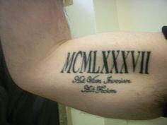 roman numeral arm tattoo