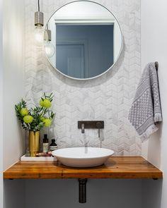 A modern powder room with marble look chevron tile. - A modern powder room with marble look chevron tile. Powder Room Tile, Modern Powder Rooms, Powder Room Vanity, Bathroom Decor, Bathrooms Remodel, Powder Room Design, Home Decor, Chevron Tile, Bathroom Design