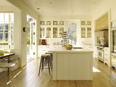 So much light! Wood, cool hood, and a massive terrace off the kitchen
