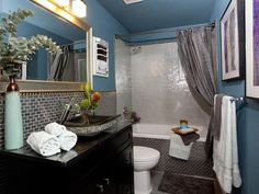 Never would have thought of full wall of pearly mosaics...and I need the light reflection too. - 99 Stylish Bathroom Design Ideas You'll Love on HGTV