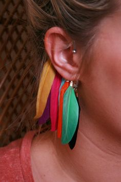 Love these colours!   Rainbow Feather ear cuff www.nativehaze.co.uk