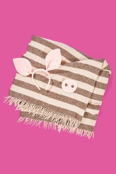 Not only will you be bundled up in the cold October air, but you'll look as cute as a button. Just slip on a pig nose and pig ears, then wrap yourself up in a blanket. Everyone will want to eat you right up! What you'll need: Pig accessories ($13; amazon.com); Mohair throw ($23; potterybarn.com)