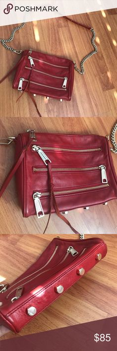 """Rebecca Minkoff mini 5 zip cross body Excellent used condition. Have so many cross-body bags that I never used this bag as much! Perfect girls night out bag or concert bag! Adds a sexy pop to any black outfit! Hardware is a light gold color. Does not come with dust bag. 9""""W x 6 ½""""H x 1 ½""""D. (Interior capacity: small.) 14"""" - 21"""" convertible strap drop. Top zip closure. Top exterior zip pocket is functional. Interior zip, wall and smartphone pockets. Protective metal feet. Material: Leather…"""