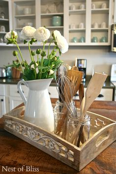 Simple to make! Tray plus plain pitcher plus flowers plus jar fiull of utensils make Beautiful!