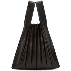 See this and similar Yohji Yamamoto tote bags - Pleated leather tote bag in black. Two carry handles. Drawstring closure at bag throat. Zip pouch at interior on...