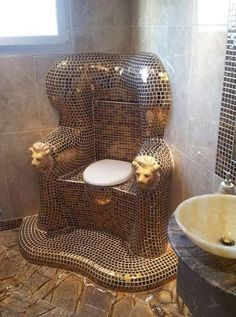 "Kitschy Living. A real throne for the"" throne room"". Must be Hell to re-grout, though."
