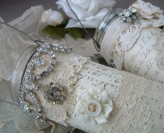 """These are just EMPTY JARS -- average upcycled jars turned into GORGEOUS little wire handled """"vases"""".  Covered in scrap paper, bits of lace and baubles."""