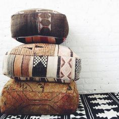 warm colored, soft, patterned poufs.