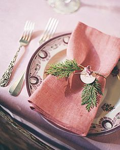 Dusty rose (didn't *everyone* inherit at least one set of dusty rose napkins from their mother?) plays well with evergreen. Rough textures also compliment mismatched flatware.