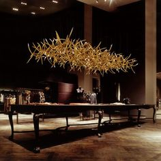 dramatic dinner table, amazing. Not your typical antler chandy...lit swarovski crystals. Yep, nailed it.