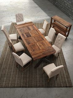 Ashbury Dining Table's intricate elm table top design and antiqued trestle base create a statement piece for any dining room. This substantial table has such a versatile design that it can be used in spaces ranging in flavor from modern to rustic to transitional to industrial. $1070