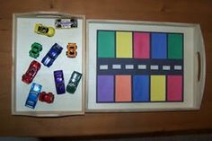 """Color Match Car Parking. Park each car in a spot that is the same color as the car.  You could also place stickers on the top of each car and match letters ie 2 red cars, one with """"A"""" one with """"a""""."""
