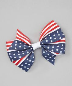 In stars and stripes, this bow is a patriotic delight. The sleek grosgrain ribbon is a bright topper to any outfit, and the comfy alligator clip keeps stray strands away.