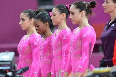 Four members of USA Gymnastics' women's Olympic team line up before competing during podium training.  from L to R: Aly Raisman, Gabby Douglas, Kyla Ross, Jordyn Wieber.  McKayla Maroney was the fifth team member.