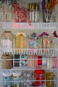 Pretty wrapping station using mason jars to organize and display essentials.