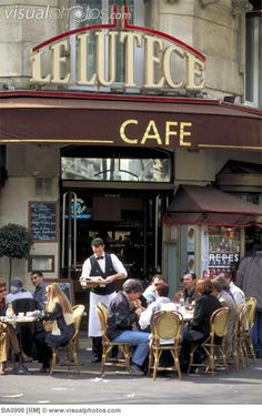 French sidewalk cafe. (Le Lutece is a cafe found on Saint Michel Boulevard in the Latin Quarter. Sidewalk cafes are popular in France for people-watching and romantic dates. Paris, France.)