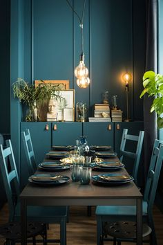 A teal dining room with Ivar  chairs and cabinets