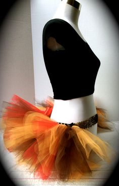 This half tutu is perfect if you dont want to wear a full tutu, but still want to join in on dressing up! This butt tutu is perfect for raves, fun runs,Turkey Trot, or just because. This half tutu is made on a gold stretch crochet band, a black sequined elastic with 2 layers of