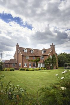 New farmhouse in Wiltshire with beautiful landscaped gardens.