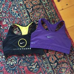 Nike Sports Bras Two Nike women's sports bra. Worn only once they realized they didn't fit me. Black is a limited edition Livestrong, purple is plain. Willing to send them as a bundle price or just individually for 19$ each. Each sports bra is sold for 45$ each I n Nike. Nike Accessories