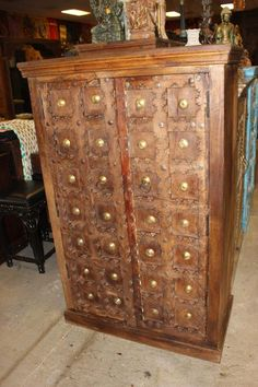 Antique Doors Indian Carved Armoire Storage Cabinet Brass Medallions Old Teak Wardrobe Chest Warm Earthy Brown Farmhouse Eclectic DEsign. Armoire Antique, Antique Doors, Armoire For Sale, Mountain Cabin Decor, Indian Doors, Eclectic Design, Eclectic Modern, Painted Drawers, Brown Doors