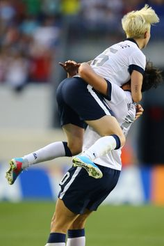 The Pinoe Leap after Abby Wambach becomes the leading scorer of all time with her 159th goal, on June 20, 2013. (Al Bello/Getty Images North America)