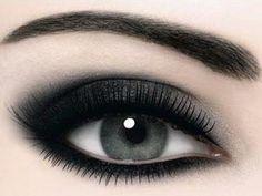 Black smoky make up on a beautiful grey/blue eye and a DARK eye brow.