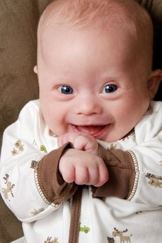 down syndrome child laughing - such a cutie! Googled for my presentation on prenatal testing.