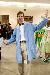 thinking Bill nye, maybe a pencil skirt bow tie and blue lab coat