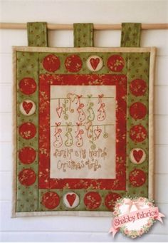 "The Heart of Christmas: This stitchery reads ""Family is the heart of Christmas time.""  All instructions are included for the 15 1/2"" x 12 1/2"" wallhanging."