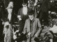 A still image from film footage of a 1904 wedding shows a man in a bowler hat believed to be the French novelist Marcel Proust. Marcel Proust, Laura Lee, Swann's Way, Top Universities, Man Ray, Wedding Show, Another World, Book Authors, Science And Technology