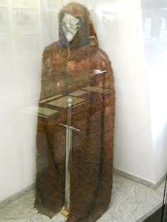 Executioner's coat from the end of the 17th century and executioner's sword 16/17th century. From http://curvyamazontravels.blogspot.com/2011/01/medieval-crime-museum-in-rothenburg.html