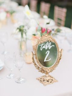This Couple Gave Guests the Donut Bar of Our Dreams Disney Table Numbers, Photo Table Numbers, Vintage Table Numbers, Unique Table Numbers, Framed Table Numbers, Wedding Reception Tables, Wedding Table Decorations, Wedding Seating, Wedding Table Numbers