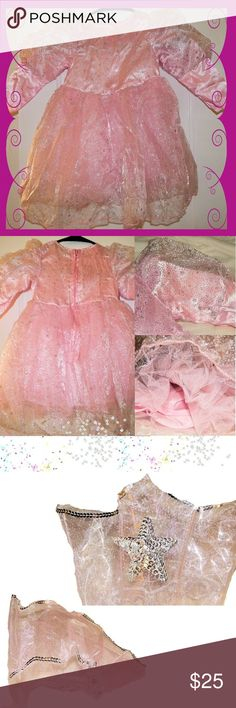 The Good Witch Deluxe Toddle Costume with 👑 Adorable, well made 'The Good Witch' toddler costume from FunCostumes. Unlike a lot of costumes this one is actually well made! It is a sheath dress with attached tulle skirt and sparkley material overlaid on top of the dress and part way down the sleeves. It zips up the back instead of just closing with Velcro. Says 18 months+ on package, my daughter was wearing 12-18 and had plenty of room. Only worn once for about an hour and she wasn't walking…