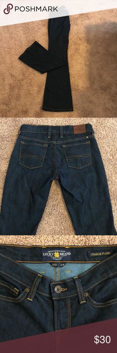 """Flared Lucky Jeans 00 Lucky Jeans, style is the """"Charlie Flare""""   Dark wash, worn only a few times. Stored in smoke-free home!  They run a little large, more like a 0. I'm 5'5"""" and they can be worn with a small (1 inch) heel. Lucky Brand Jeans Flare & Wide Leg"""