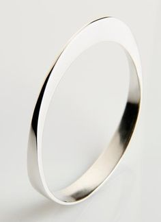 The enduring allure of classic style...These forged bangles are are beautiful statement piece for all occasions. They can be worn on their own or a few together. Most people who wear them just never take them off!