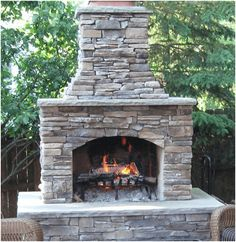 ideas outdoor patio diy stones living spaces for 2019 Outdoor Fireplace Kits, Outside Fireplace, Backyard Fireplace, Outdoor Fireplaces, Fireplace Ideas, Fireplace Stone, Outdoor Wood Burning Fireplace, Fireplace Candles, Propane Fireplace