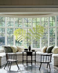 Custom banquette to fit this large window. I would still like the tufted look with back support as well with storage option underneath. Would want a oval drop leaf dining table in front. To me, the chairs and table look out of place.